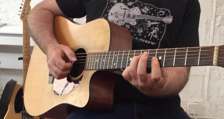 dar clases de guitarra